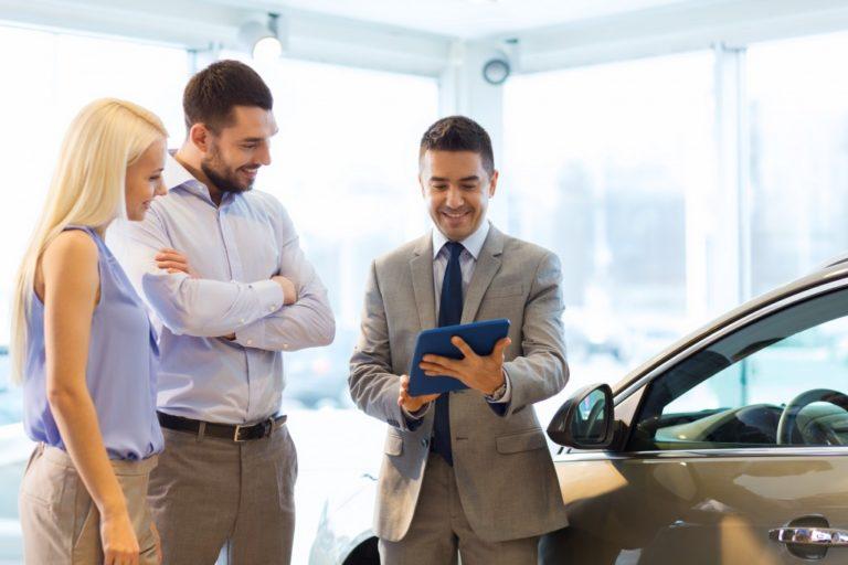 couple buying car at dealership