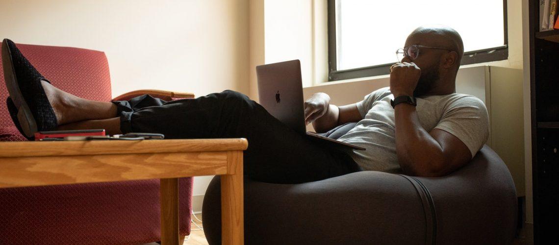 man using his computer
